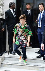 David Beckham and his son Cruz leave after attending the Victoria Beckham London Fashion Week SS19 show in Dover Street, London.