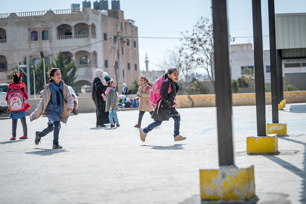 18 February 2020, Amman, Jordan: Girls play during recess at the Rufaida Al Aslamieh Primary Mixed School in the Sahab district. The school serves more than 1,000 students from kindergarten up to 10th grade, most of them girls from Jordan but also some from Syria and other countries, and, in the lower grades, also boys.