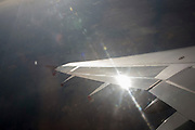 Sun glinting off mid-Channel airliner wing and airspace.