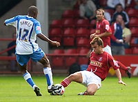 Photo: Daniel Hambury.<br />Walsall v Swindon. Coca Cola League 1.<br />03/09/2005.<br />Swindon's  Ricky Shakes and Walsall's Michael Standing compete for the ball