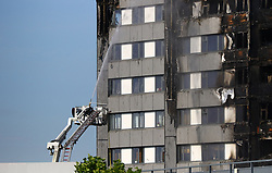 Emergency services spray water after a fire engulfed the 24-storey Grenfell Tower in west London.