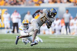 Sep 11, 2021; Morgantown, West Virginia, USA; West Virginia Mountaineers wide receiver Sam James (13) catches a pass and is tripped up by Long Island Sharks safety Derrick Edafe (15) during the second quarter at Mountaineer Field at Milan Puskar Stadium. Mandatory Credit: Ben Queen-USA TODAY Sports