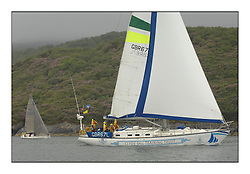 Boats arrive in feeder races in light rain to Tarbert Harbour for the 33rd Scottish Series supported by Bell Lawrie.GBR67L Clyde Challenger CYCA Class 9.