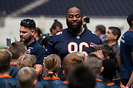 Akeem Hicks (DT, Chicago Bears) greets the kids ahead of todays NFL Flag National Championship Finals during the NFL UK Media Day at Tottenham Hotspur Stadium, London, United Kingdom on 3 July 2019.