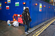 Wet day on Brick Lane in the East End of London, UK. Man on the streets wearing some fashionable gear.