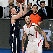 Anadolu Efes's Dusko Savanovic (L) and Olympiacos's Pero Antic (R) during their Turkish Airlines Euroleague Basketball Top 16 Group E Game 4 match Anadolu Efes between Olympiacos at Sinan Erdem Arena in Istanbul, Turkey, Wednesday, February 08, 2012. Photo by TURKPIX