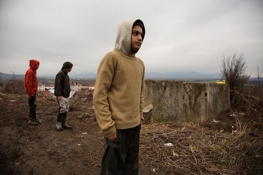 Boys in the Roma settlement in Ostrovany, Slovakia. L-R, David Kotler (12), Lubomir Kaleja (12) and Ferko (12).
