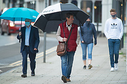 © Licensed to London News Pictures 18/05/2021.  Sevenoaks, UK. Shoppers getting wet again in Sevenoaks High Street in Kent this afternoon. The wet weather continues today in Kent with little sign of letting up. Photo credit:Grant Falvey/LNP