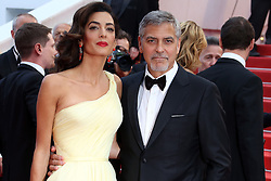"""File photo : George and Amal Clooney arriving to the Money Monster premiere as part of the 69th Cannes Film Festival at Palais des Festivals on May 12, 2016 in Cannes, France. Amal Clooney and her husband George are expecting twins, US media report. The babies are due in June, according to CBS's The Talk host Julie Chen. Another source close to the couple, quoted by People, said they were """"very happy"""". The Clooneys' representatives have not yet commented. Photo by Francois Maquaire/ABACAPRESS.COM"""