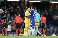 Goalkeeper Iker Casillas of FC Porto winks at John Terry, the Chelsea captain after the final whistle. UEFA Champions league group G match, Chelsea v Porto at Stamford Bridge in London on Wednesday 9th December 2015.<br /> pic by John Patrick Fletcher, Andrew Orchard sports photography.