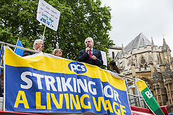 London, UK. 19 June, 2019. Shadow Chancellor John McDonnell addresses outsourced catering, security, postal, porter and cleaning staff belonging to the Public & Commercial Services Union (PCS) and working at the Department for Business, Energy and Industrial Strategy (BEIS) via contractors ISS World and Aramark at a rally outside Parliament on the third day of continuing industrial action for the London Living Wage, terms and conditions comparable to the civil servants they work alongside and an end to outsourcing.