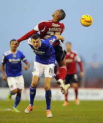 Bristol City's Tyrone Barnett battles for the high ball with Oldham Athletic's James Wilson - Photo mandatory by-line: Joe Meredith/JMP - Tel: Mobile: 07966 386802 08/02/2014 - SPORT - FOOTBALL - Oldham - Boundary Park - Oldham Athletic v Bristol City - Sky Bet League One