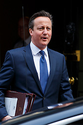 © licensed to London News Pictures. London, UK 18/03/2015. Prime Minister David Cameron attending to a cabinet meeting in Downing Street on the Budget Day, Wednesday, 18 March 2015. Photo credit: Tolga Akmen/LNP