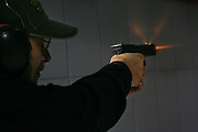 Man in a firing range practice