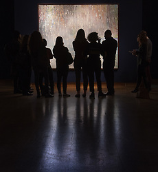 Christie's, London, March 3rd 2017. PICTURED: Gallery visitors admire Peter Doig's 'Cobourg 3 + 1 More' which is expected to fetch between £8-12 million. <br /> Fine art auctioneers Christies hold a press preview for their Post-War and Contemporary Art auctions to be held on March 7th and 8th.