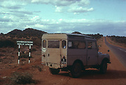 Landrover type overland adventure vehicle at Tropic of Capricorn sign Steenbokskeerkring, South Africa 1964