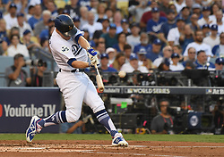 October 24, 2017 - Los Angeles, California, U.S. - Los Angeles Dodgers' Enrique Hernandez singles against the Houston Astros in the second inning of game one of a World Series baseball game at Dodger Stadium on Tuesday, Oct. 24, 2017 in Los Angeles. (Photo by Keith Birmingham, Pasadena Star-News/SCNG) (Credit Image: © San Gabriel Valley Tribune via ZUMA Wire)