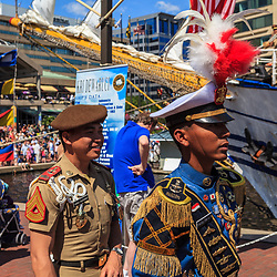 Baltimore, MD, USA - June 16, 2012: Naval Officers with distinct, colorful uniforms walk around the Inner Harbor in the City of Baltimore, Maryland.
