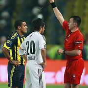 Referee's Huseyin GOCEK (R) show the red card to Fenerbahce's Gokcek VEDERSON (L) and Besiktas's Ibrahim TORAMAN (C) during their Turkish superleague soccer derby match Fenerbahce between Besiktas at Sukru Saracaoglu stadium in Istanbul Turkey on Sunday 18 April 2010. Photo by TURKPIX