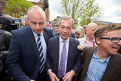 © Licensed to London News Pictures.  30/04/2015. AYLESBURY, UK. Nigel Farage (centre), UKIP party leader, talks to potential voters during a campaign visit to Aylesbury. Photo credit: Cliff Hide/LNP