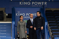© Licensed to London News Pictures. 28/11/2018. Leicester, UK. The Duchess of Cambridge (L), The Duke of Cambridge (C) and Aiyawatt Srivaddhanaprabha (R) view Leicester City Football Club King Power Stadium to pay tribute to those who were tragically killed in the helicopter crash at Leicester City Football Club's King Power Stadium in Leicester, Britain, on Nov. 28, 2018.  Their Royal Highnesses knew the Club's Chairman, Vichai Srivaddhanaprabha, and wanted to visit the city to recognise the warmth and compassion that the people of Leicester and fans of Leicester City Football Club have shown in reaction to the accident. Photo credit: Ray Tang/LNP