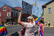 Peterson Toscano holds a Black Lives Matter sign at 4th and Chestnut Streets during the Mifflinburg Pride Event.