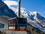 Dome du Gouter (Dôme du Goûter 14,121 feet or 4304 meters) is a shoulder of massive Mont Blanc (out of sight to left at 15,782 feet). Take the spectacular Aiguille du Midi téléphérique (world's highest vertical ascent cable car) from Chamonix (3300 feet elevation) to Aiguille du Midi (12,600 feet) in France, Europe.