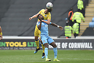 Bristol Rovers midfielder Ed Upson (6) heads the ball under pressure from Coventry City forward (on loan from Wolverhampton Wanderers) Bright Enobakhare (24) during the EFL Sky Bet League 1 match between Coventry City and Bristol Rovers at the Ricoh Arena, Coventry, England on 7 April 2019.