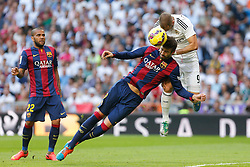 25.10.2014, Estadio Santiago Bernabeu, Madrid, ESP, Primera Division, Real Madrid vs FC Barcelona, 9. Runde, im Bild Real Madrid´s Karim Benzema (R) and Barcelona´s Dani Alves (L) and Pique // during the Spanish Primera Division 9th round match between Real Madrid CF and FC Barcelona at the Estadio Santiago Bernabeu in Madrid, Spain<br /> <br /> ***** NETHERLANDS ONLY *****