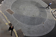 Aerial view of city pedestrians on the periphery of circles at a City of London roundabout