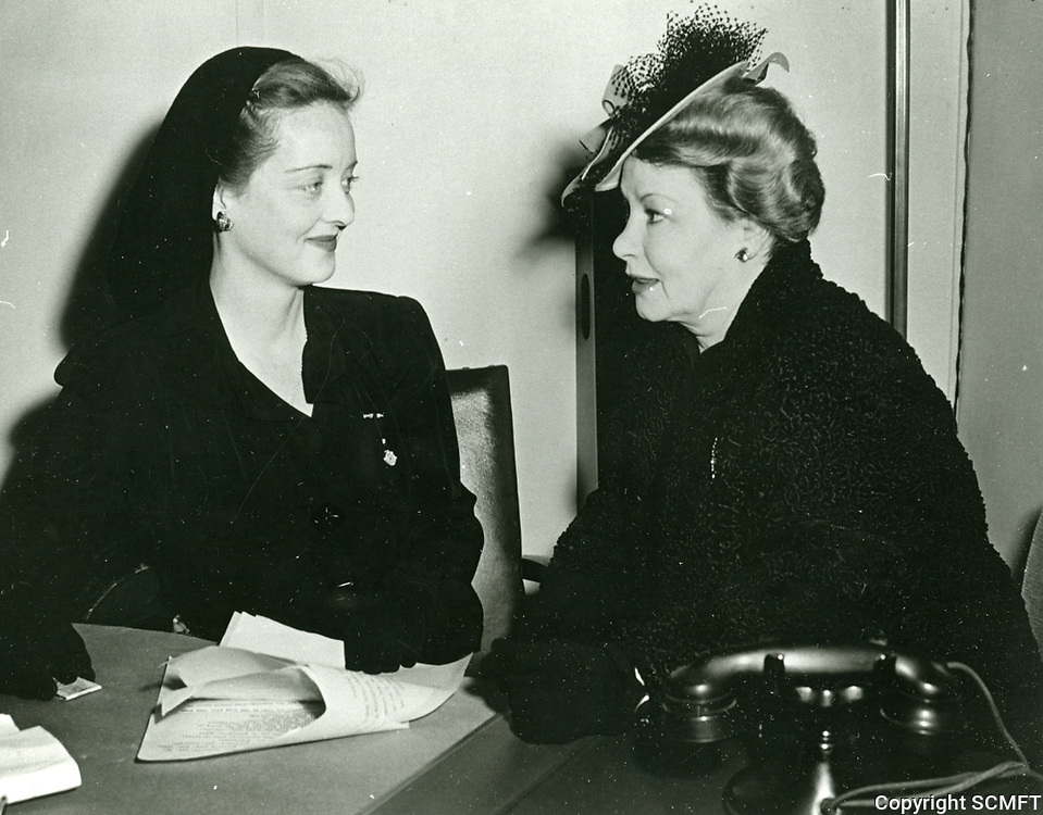 1942 Hollywood Canteen founder, Bette Davis meets with a volunteer at the Canteen.