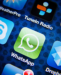 detail of iPhone 4G screen showing WhatsApp instant messaging app