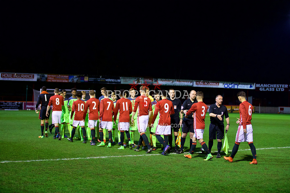 ALTRINGHAM, ENGLAND - Friday, March 10, 2017: Liverpool and Manchester United players shake hands before an Under-18 FA Premier League Merit Group A match at Moss Lane. (Pic by David Rawcliffe/Propaganda)