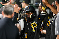 Jun 15, 2018; Pittsburgh, PA, USA; Pittsburgh Pirates second baseman Josh Harrison (5) celebrates with teammates after scoring a run during the sixth inning against the Cincinnati Reds at PNC Park. Mandatory Credit: Ben Queen-USA TODAY Sports
