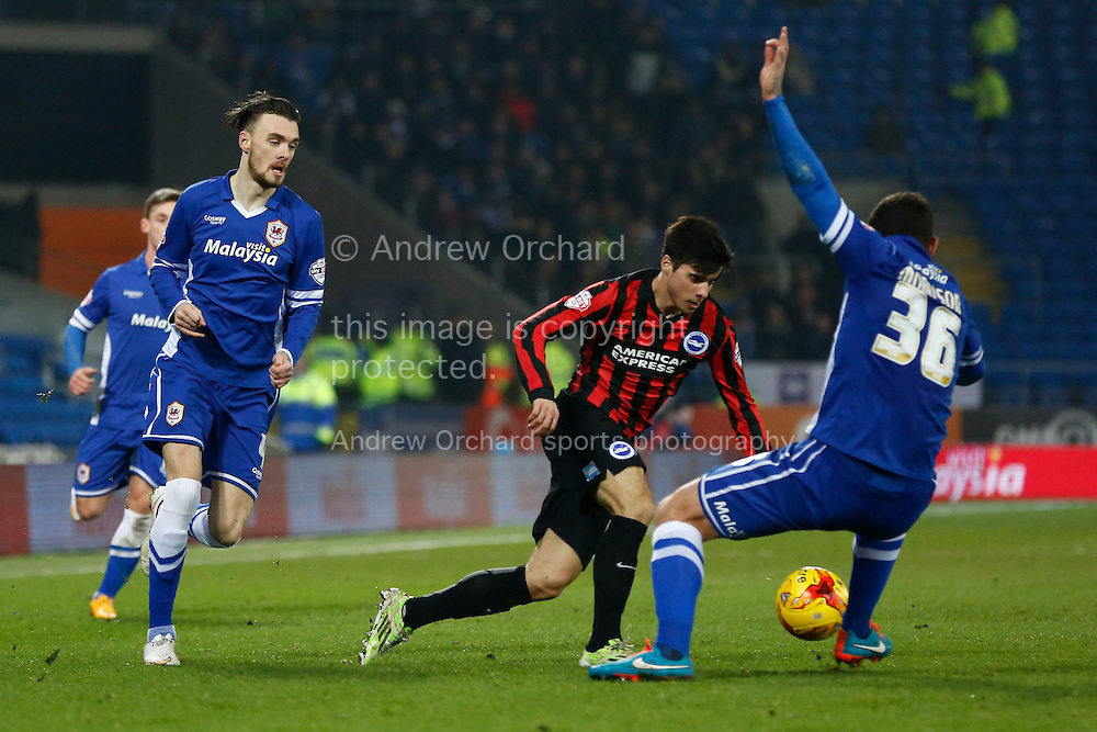 Joao Teixeira of Brighton takes the ball past Sean Morrison of Cardiff City.<br /> Skybet football league championship match, Cardiff City v Brighton & Hove Albion at the Cardiff city Stadium in Cardiff, South Wales on Tuesday 10th Feb 2015.<br /> pic by Mark Hawkins, Andrew Orchard sports photography.