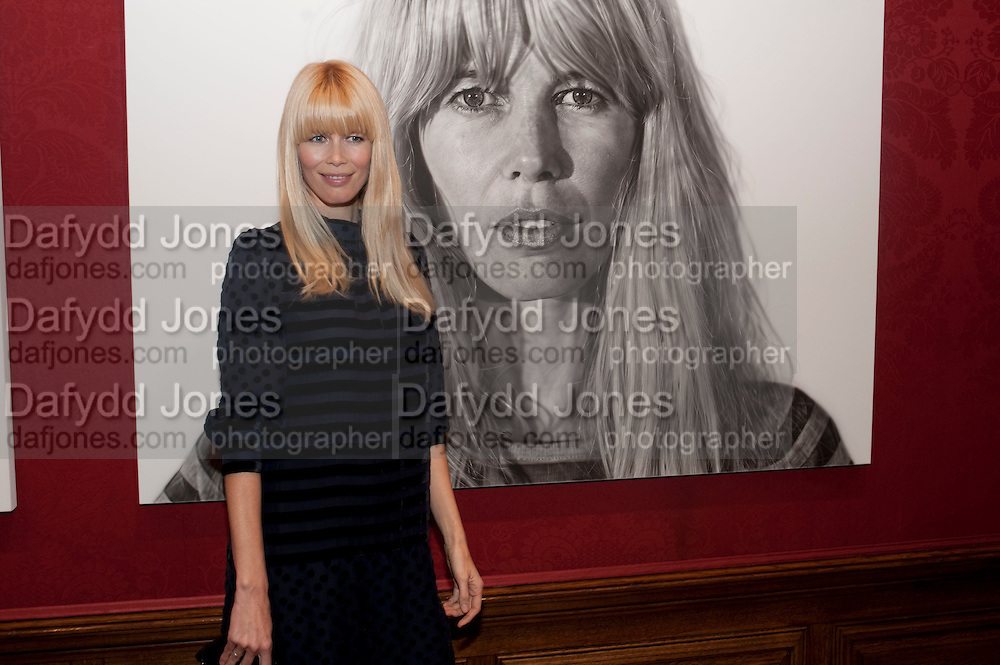 CLAUDIA SCHIFFER IN FRONT OF JASON BROOK'S PORTRAIT OF HER, Capturing Claudia. Interpretations of Claudia Schiffer by leading contemporary artists for Harpers Bazaar magazine. Colnaghis Gallery. Old Bond st. and afterwards at Locanda Locatelli's restaurant. Portman sq. London. 2 November 2009.