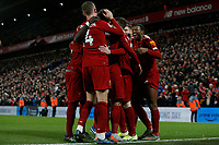 Football - 2019 / 2020 Premier League - Liverpool vs. Everton<br /> <br /> Georginio Wijnaldum of Liverpool celebrates with his team mates after he scores to make it 5-2 in the final minutes of the game, at Anfield.<br /> <br /> COLORSPORT/ALAN MARTIN