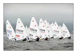 Women's Start  with Reka Kare, HUN 183532, Alberte Lindberg, DEN 192678.Opening races in breezy conditions for the Laser Radial World Championships, taking place at Largs, Scotland GBR. ..118 Women from 35 different nations compete in the Olympic Women's Laser Radial fleet and 104 Men from 30 different nations. .All three 2008 Women's Laser Radial Olympic Medallists are competing. .The Laser Radial World Championships take place every year. This is the first time they have been held in Scotland and are part of the initiaitve to bring key world class events to Britain in the lead up to the 2012 Olympic Games. .The Laser is the world's most popular singlehanded sailing dinghy and is sailed and raced worldwide. ..Further media information from .laserworlds@gmail.com.event press officer mobile +44 7775 671973  and +44 1475 675129 .