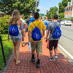 Newark, DE – June 24, 2013: Students walking on a downtown main street near the University of Delaware campus.