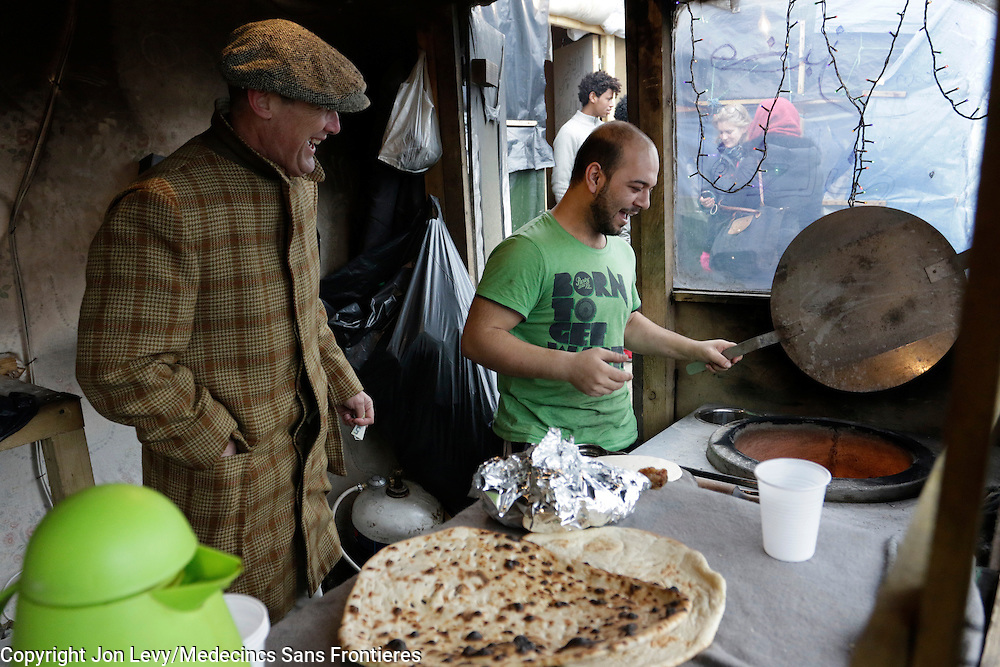 Writer AA Gill watches a baker from Barri Italy make naan bread in a small make-shift bakery in the refugee camp in Calais France. <br /><br /><br />Calais: AA Gill visits the refugee camps of Calais and Grande Synthe in Dunkirk.