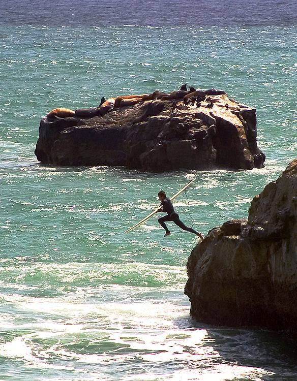 Surfer dropping in, Santa Cruz, California