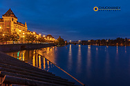 Bellevue Building reflects in the Vltava River at dawn in Prague, Czech Republic