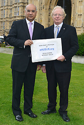 © Licensed to London News Pictures. 14/05/2013. Westminster, UK. Keith Vaz MP, Trevor Murby. Patients campaigning for a life-saving treatment to be made available for all sufferers of the rare blood disease atypical Haemolytic Uraemic Syndrome (aHUS) present an urgent petition with over 30,000 signatures to MPs at the House of Commons on Tuesday May 14 2013... Photo credit : Stephen Simpson/LNP