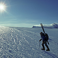 ANTARCTICA. Mountaineer Hector MacKenzie on bare ice glacier in southern Ellsworth Mountains.  Mount Fordell bkg.