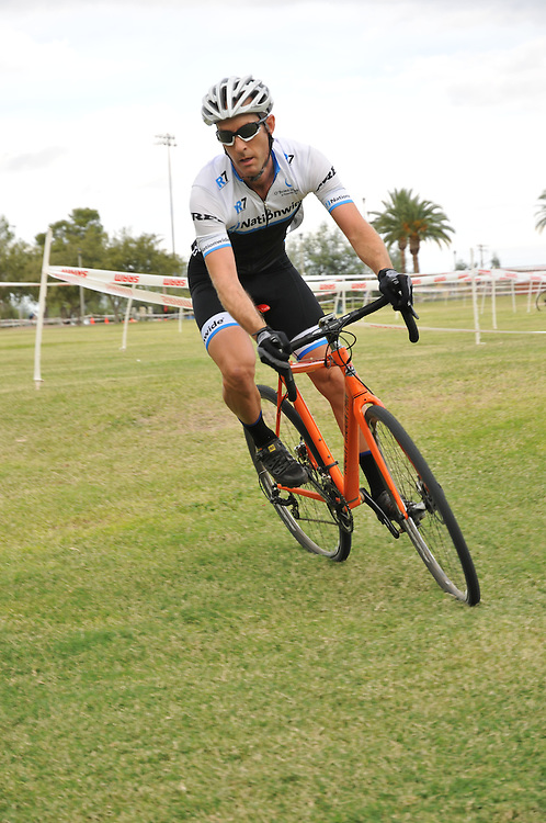 Racer warming up before Cyclovia Tucson fall 2014 cyclocross in Mansfield Park. Bike-tography by Martha Retallick.