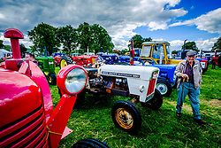 The 44th Biggar Vintage Vehicle Rally held in Biggar on 13th August 2017.  An old farmer admiring the vintage tractors.<br /> <br /> (c) Andrew Wilson   Edinburgh Elite media