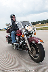 Jonathan Pite on Aidan's Ride to raise money for the Aiden Jack Seeger nonprofit foundation to help raise awareness and find a cure for ALD (Adrenoleukodystrophy) during the annual Sturgis Black Hills Motorcycle Rally. I-90 between Rapid City and Sturgis, SD, USA. Tuesday August 8, 2017. Photography ©2017 Michael Lichter.