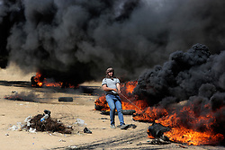 Palestinian protesters take part during clasheswith Israeli soldiers at the border fence with Israel east of Khan Yunis in the southern Gaza Strip, Israeli soldiers killed at least 60 Palestinians and wounded more than 2,700. as demonstrations on the Gaza-Israel border coincided with the controversial opening of the U.S. Embassy in Jerusalem. This marks the deadliest day of violence in Gaza since 2014. Gaza's Hamas rulers have vowed that the marches will continue until the decade-old Israeli blockade of the territory is lifted. Gaza Strip, Palestine, May 15, 2018. Photo by Ashraf Amra/SalamPix/ABACAPRESS.COM