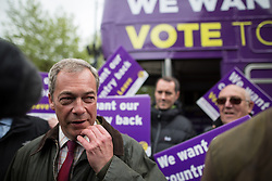© Licensed to London News Pictures . 25/05/2016 . Bolton , UK . NIGEL FARAGE with supporters . The UKIP referendum bus tour , campaigning for a UK Brexit , lead by Nigel Farage , in Victoria Square , Bolton . Photo credit : Joel Goodman/LNP