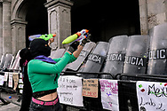 TOLUCA, MEXICO - MARCH 8: А woman confronts a riot police line, in a protest against gender-based violence, in the context of International Women's Day. Hundreds of women take part in demonstrations worldwide, to demand justice for victims of femicide and stop violence against women, during the commemoration of International Women's Day .  on March 8, 2021 in Toluca, Mexico